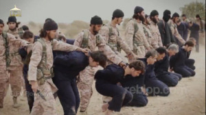 ISIS recruits prepare to behead 19 captured Syrian pilots and military officers in a ritualistic ceremony. This marks their formal induction into the ranks of the jihadis through the shedding of blood.