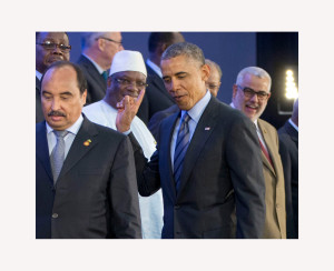 Obama flashes the finger shahada in response to a cry of Allahu Akbar that came from off camera behind him.